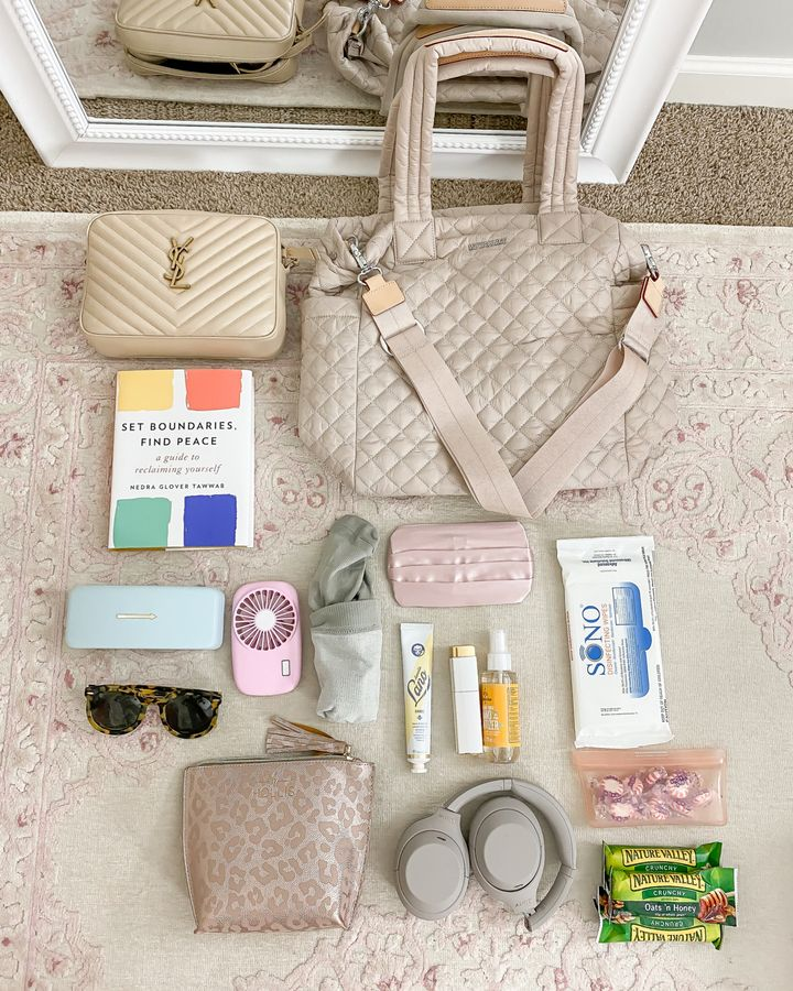flatlay of carry on bag and essentials for Babymoon Packing List